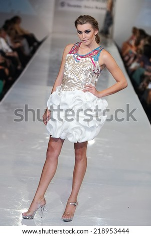SCOTTSDALE, AZ - OCTOBER 3: Models showcasing designs from the Brandon McDonald collection during a runway show at the Phoenix Fashion Week at Talking Stick Resort on Oct. 3, 2013 in Scottsdale, AZ.  - stock photo