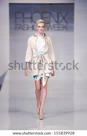 SCOTTSDALE, AZ - OCTOBER 6: Models showcasing designs from the Bri Seeley collection during a runway show at the Phoenix Fashion Week on October 6, 2012 in Scottsdale, Arizona.  - stock photo