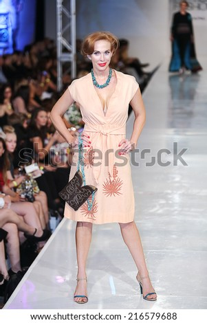 SCOTTSDALE, AZ - OCTOBER 3: Models showcasing designs from the Robert Black collection during a runway show at the Phoenix Fashion Week at Talking Stick Resort on October 3, 2013 in Scottsdale, AZ.  - stock photo