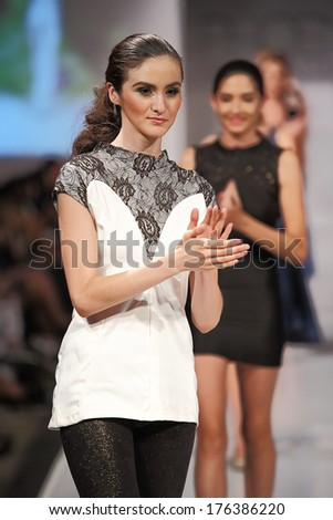 SCOTTSDALE, AZ - OCTOBER 5: Models showcasing designs from the Sew Twisted collection during a runway show at the Phoenix Fashion Week on October 5, 2012  in Scottsdale, Arizona. - stock photo