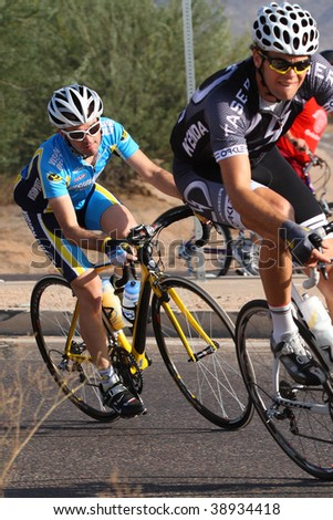 SCOTTSDALE, AZ - OCTOBER 4:Racers make the turn after a 10 mile downhill in the 6th annual Tour de Scottsdale, a charity bicycle race on Saturday October 4, 2009 in Scottsdale Arizona