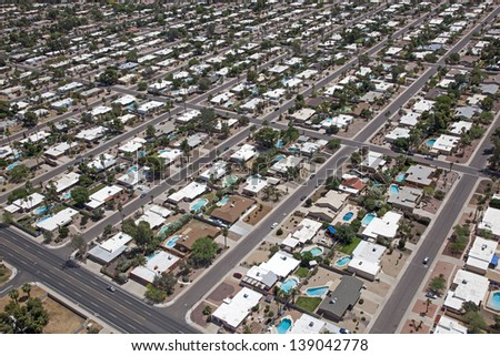Scottsdale Suburb with swimming pools and palm trees - stock photo