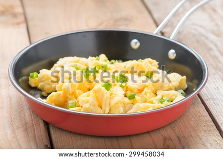 Scrambled egg in a frying pan. - stock photo
