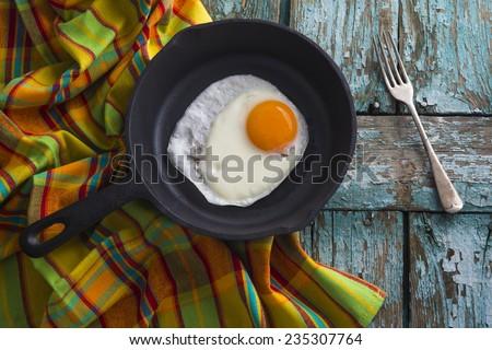scrambled egg in pan - stock photo