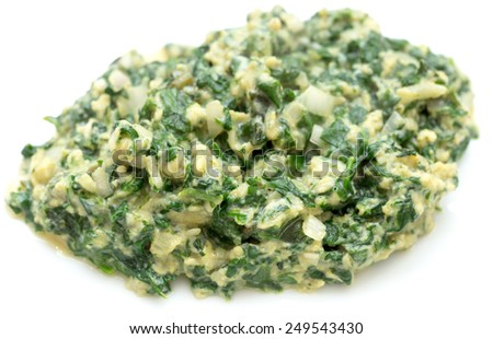 Scrambled egg with spinach, onion and basil. Italian style uova strapazzate al verde, on a white plate. - stock photo