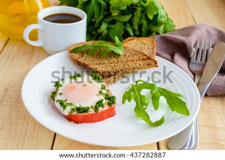 eggs, baked in a ring bell pepper, toast, arugula leaves and a cup ...