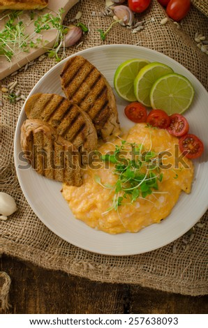 Scrambled eggs, creamy and fluffy, panini toast, lime and tomato