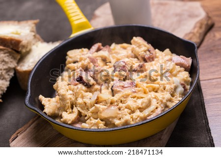 Scrambled eggs on the frying pan