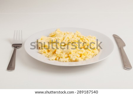 scrambled eggs on the plate  - stock photo