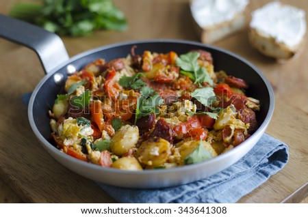 Scrambled eggs with chorizo and roast peppers - stock photo