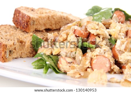 Scrambled eggs with frankfurters and spinach, wholemeal bread
