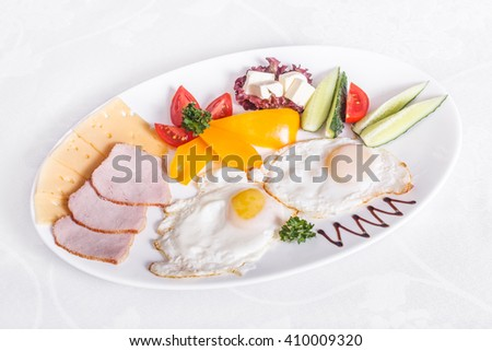 Scrambled eggs with ham, cheese and vegetables - stock photo