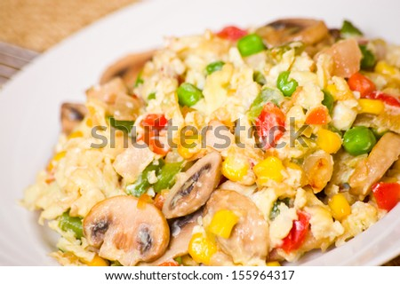 scrambled eggs with mushrooms and vegetables