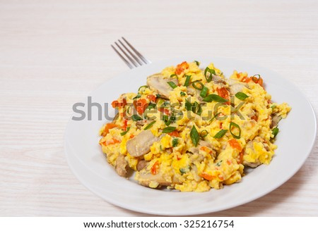 scrambled eggs with mushrooms and vegetables - stock photo