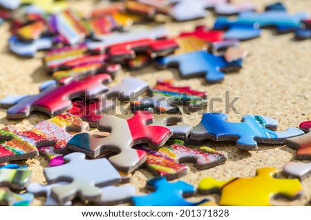 Scrambled puzzle pieces, conceptual business or feeling lost image - stock photo