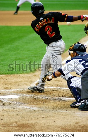 SCRANTON - JULY 31: Rochester Red Wings' Alexi Casilla  (No. 2) swings at a pitch in a game against the Scranton Wilkes Barre Yankees at PNC Field on July 31, 2008 in Scranton, PA. - stock photo