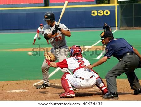 SCRANTON - JULY 31: Rochester Red Wings batter, Garrett Jones takes a swing against the Scranton Wilkes Barre Red Barons in a game at PNC Field July 31, 2005 in Scranton, PA. - stock photo
