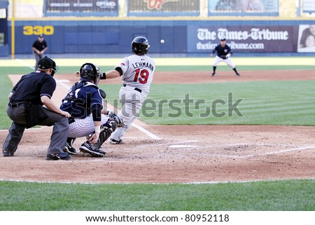 SCRANTON, PA - JULY 9: Rochester Red Wings batter  Danny Lehmann hits a line drive during a game against the Scranton Wilkes Barre Yankees at PNC Field on July 9, 2011 in Scranton, PA. - stock photo
