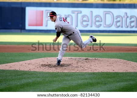 SCRANTON, PA - JULY 9: Rochester Red Wings pitcher Jake Stevens fires a pitch in a game against the Scranton Wilkes Barre Yankees at PNC Field on July 9, 2011 in Scranton, PA. - stock photo