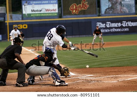 SCRANTON, PA - JULY 9: Scranton Wilkes Barre Yankees batter Jorge Vasquez swings at pitch during a game against the Rochester Red Wings at PNC Field on July 9, 2011 in Scranton, PA. - stock photo
