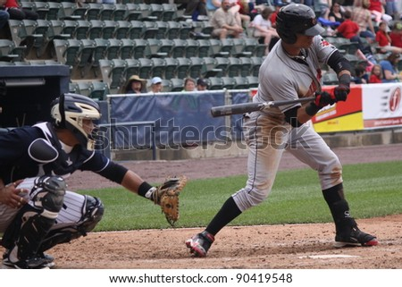 SCRANTON, PA - MAY 24: Indianapolis Indians center fielder Gorkys Hernandez swings at a pitch in a game against the Scranton Wilkes Barre Yankees at PNC Field on May 24, 2011 in Scranton, PA. - stock photo