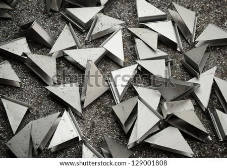 Scrap aluminum  triangle shape background - stock photo