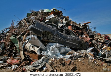 scrap metal, plastic and blue sky - stock photo
