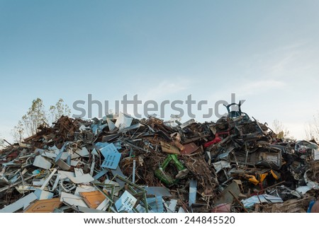 scrap metal with clear blue sky - stock photo
