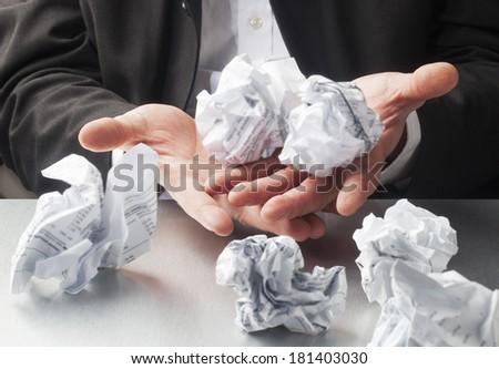 scrap paper balls displayed in hands - stock photo