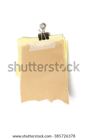 Scrap paper taped on sticky note with paper clip hanging on nail. - stock photo