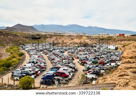 Scrap Yard With Pile Of Crushed Cars in tenerife canary islands spain - stock photo