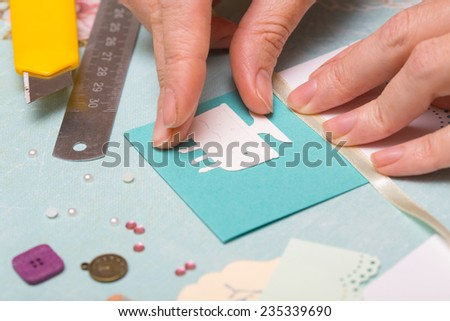 scrapbook background. Card and tools with decoration. Hands  - stock photo