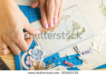 scrapbook background. Hands, Card and tools with decoration