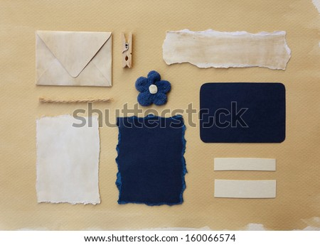 Scrapbook elements collection. Vintage mail envelope, blue and white paper scraps, card, flower decoration, pin and rope.