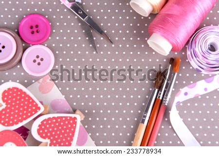 Scrapbooking craft materials on bright background - stock photo