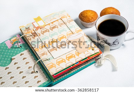 scrapbooking, photo album handmade cup of coffee with muffins on a white background