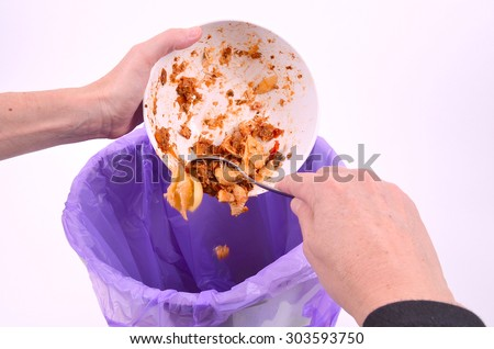 Scraping Food from a Bowl - stock photo