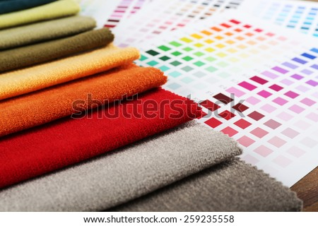 Scraps of colored tissue with palette close up - stock photo