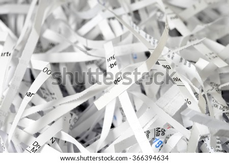 Scraps of paper from a paper shredder / Scraps of paper