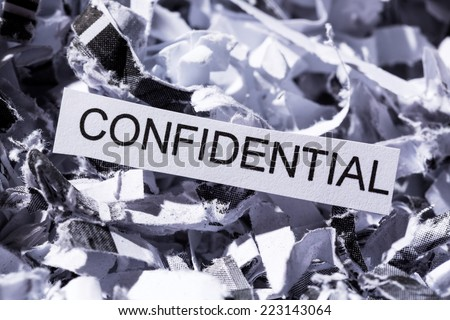 scraps of paper with the heading confidential, symbol photo for data destruction, banking secrecy and confidentiality - stock photo