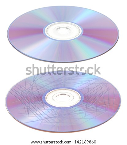Scratched and clean cd of dvd disc isolated to white background - stock photo