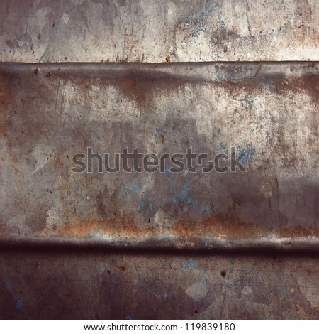 scratched and smithed metal  plate ; grunge background - stock photo