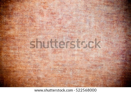 Scratched and worn wood plank - background texture.