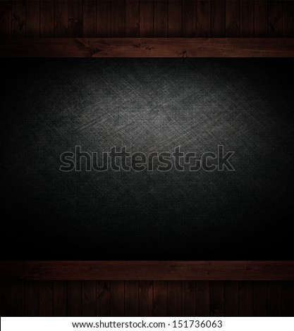 scratched dark texture on wood background.