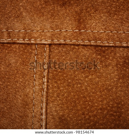 Scratched worn suede texture with seam - stock photo