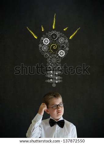 Scratching head thinking boy dressed up as business man with bright idea gear cog lightbulb on blackboard background - stock photo