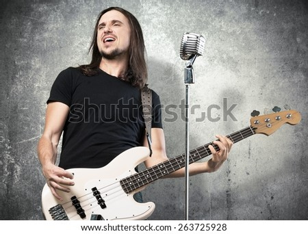 Scream. Excited Guitarist - stock photo