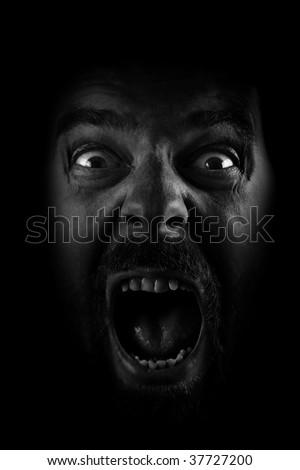Scream of Evil Crazy Scary Man in the Dark - stock photo