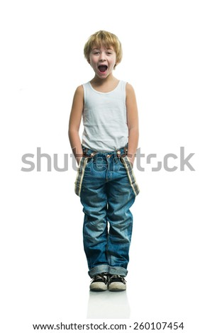 Screaming boy in jeans on the white background - stock photo
