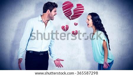 screaming couple having argument against white background - stock photo